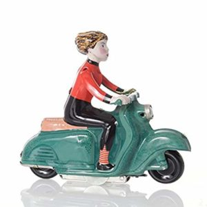 statuette of girl on scooter